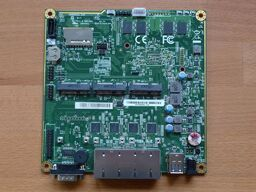 APU4B4 board on a wooden surface (front side).