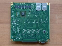 APU4B4 board on a wooden surface (back side).